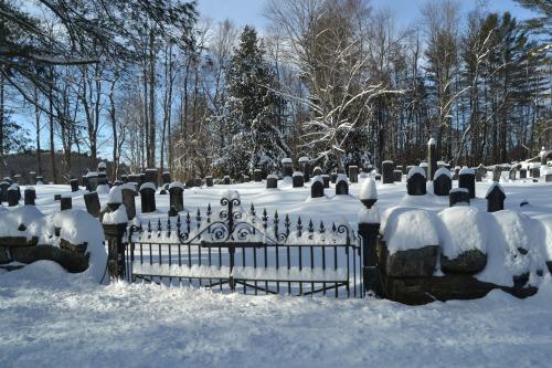 snowy cemetery gate