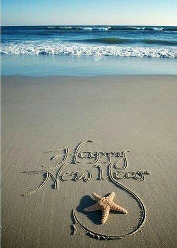 happy new year written in sand | these days of mine