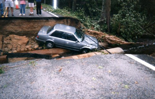 car-in-washed-out-road-10-6-2016-3-10-29-pm